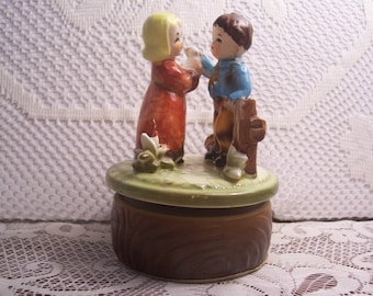 Musical Rotating Little Girl and Boy Standing by a Fence Figurine, Japan