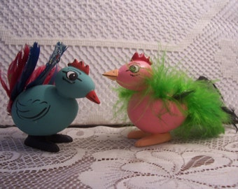 Two Rooster Figurines with Feather Tails