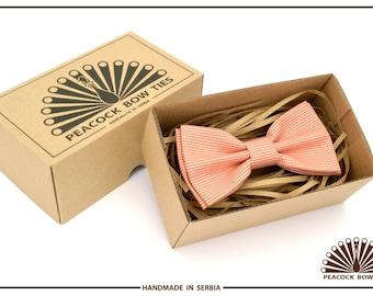 High quality handmade cotton bow tie. Orange Houndstooth.