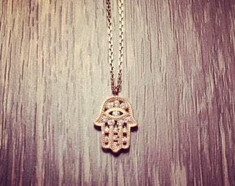 Rose gold plated Hamsa necklace decorated with CZ crystals