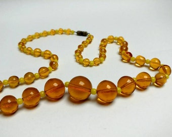Vintage necklace with yellow orange glass beads