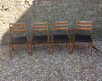 4 1960s teak and vinyl dining/kitchen chairs