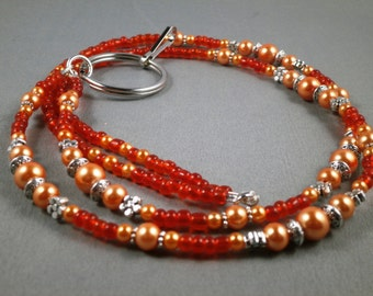 "Orange glass pearls and crystal ID lanyard . Your choice of lenght 32"" to 42"" and clasp magnetic , toggle or no opening"
