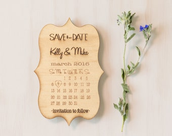 Wooden save the date card.