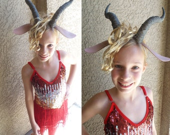 Madam Gazelle costume dress horned headband with ears red leg-warmers.