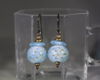 Aqua blue lampwork bead with aqua blue disc. Antiqued  bronze components