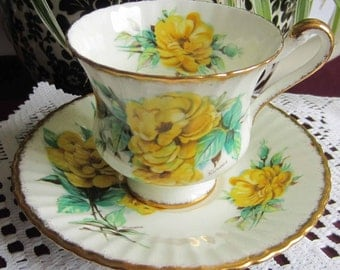 Paragon D50L features Bright Yellow Flowers with Green Foliage - Bone China Tea Cup and Saucer