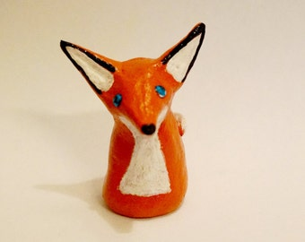 Small clay fox (with blue glass eyes)