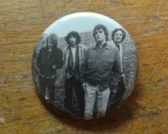 """The replacements 1.25"""" button"""