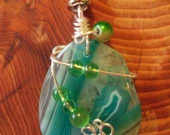 Beautiful green hues in this large 'Druzy' Agate stone-decorated with wire wrap + added glass beads.