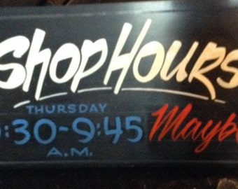 Handpainted shop hours sign