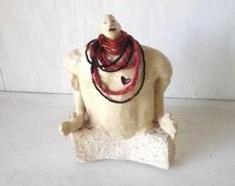 Male statue, white ceramic nude, naked figure, red and black beads, red heart tribal art, be my Valentine