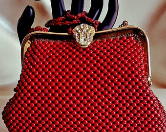 Red beaded  clutch  purse  with  chain
