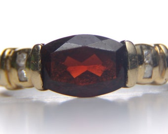 10 kt gold red Tourmaline and diamond ring size 7