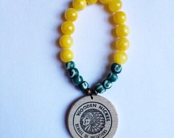 yellow & green wooden nickel bracelet