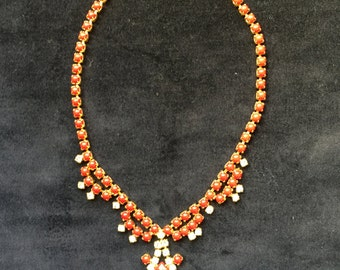Red stone and rhinestone necklace in goldtone setting