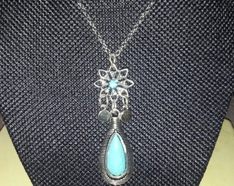 Turquoise colored stone and Flower Necklace