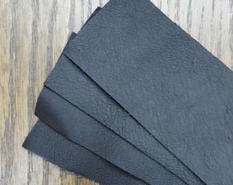 Soft black leather scraps