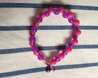 Colourful beaded bracelet on wax cord