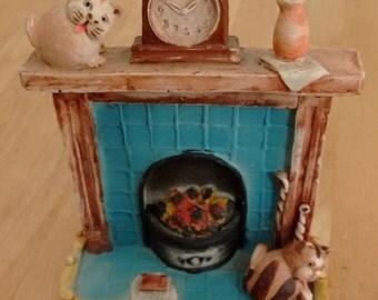 Peter Fagan, cats on a fireplace