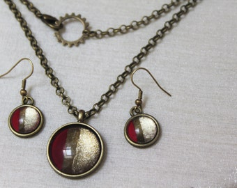 Gemstone earrings and necklace with red and gold enameled glass