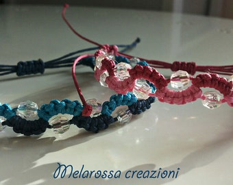 Macrame bracelet blue/pale blue, pink and black faceted bicone beads waxed cotton with transparent sliding closure.