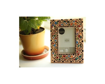 African stain glass mosaic picture frame, in yellow. wood frame, mosaic tiles. bright, shining, optimistic.