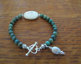 African turquoise with silver toggle and opal stones.