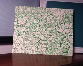 Green and white Zentangle inspired art