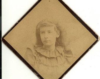 Diamond shaped vintage photo young girl circa 1880s long hair