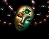 Starburst Sun Goddess handmade Face Cab Metallic Emerald Green, Gold, & Black Polymer Clay Cabochon