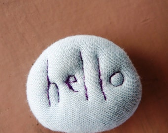 Hello Textile brooch with embroidered word