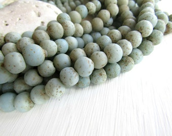 light blue glass beads,  rustic round  lampwork beads, matte opaque , gritty textured aged look , indonesian   (16 beads)  6ak1-4