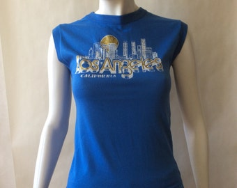 1980's Los Angeles California sleeveless 'muscle' tee, true blue with gold glitter and white citiscape screenprint, women's small