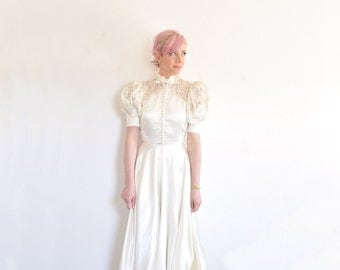 1940 lace top wedding gown . ivory satin puff sleeves and bow tie neck .small .sale