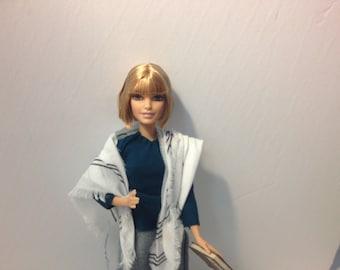 Tallit Barbie (no tefillin)--blonde hair, white skin, doing Daf Yomi