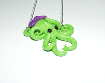 glow in the dark, green octopus necklace with purple bow,  semi translucent, opalescent, sparkly, glitter, specks, spots, pastel