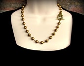 Floral Toggle and Pearl Necklace in Antique Brass