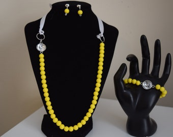 Yellow and white necklace, bracelet, and earrings set