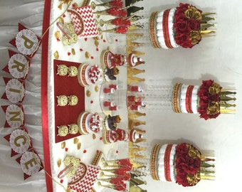 red and gold baby shower candy buffet centerpiece with baby shower