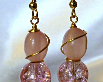 Pink pearl and crystal look earrings with wire swirl accents