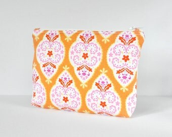 Woman's padded beauty bag intricate print travel padded make up cosmetics pouch in orange,pink,white and red in large.
