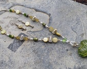 Necklace and Earring Set : Beautiful blown glass heart with a swirl of green and yellow and natural mother of pearl, jade and real pearls