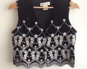 Embroidered black suede vest