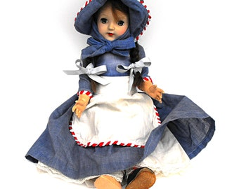1950s Ideal Toni Doll P-91 Pioneer Girl with Brunette Hair French Braid Pigtails in a Denim Dress with Apron, Bonnet and Lace Trim Petticoat