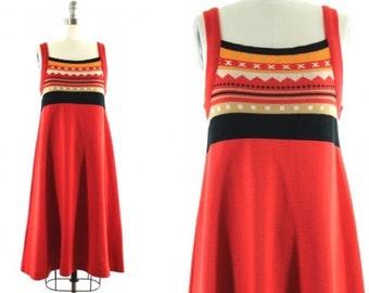 1970s orange flared dress •  retro printed jumper •  orange tent dress •  tribal print dress •  A line dress M