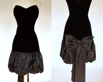1980s black velvet dress, strapless wiggle dress with ruffled satin hem and big back bow, Roberto CA, small