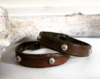 Brown leather bracelet with silver spots, studs