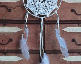 Huge white dream catcher made with leather and feathers.