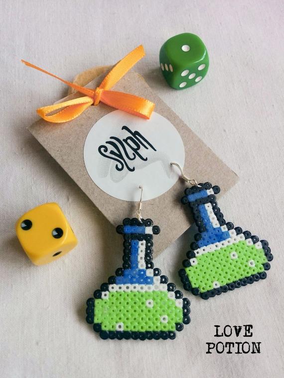 Light green chemistry vial Love Potion earrings for gamer girls in oldschool 8bit games' style